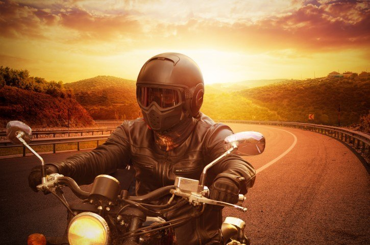 young man riding motorcycle